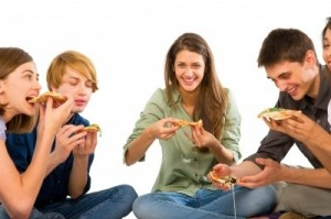 Smiling Teenagers Eating Pizza by Ambro